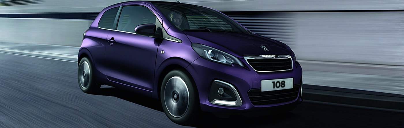 Peugeot 108 in purple driving at high speed